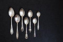Colheres de prata na tabela Imagens de Stock Royalty Free