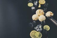 Colheres do gelado com gelo no fundo preto Foto de Stock Royalty Free