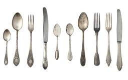 Colheres, forquilhas e facas do vintage isoladas em um fundo branco fotografia de stock royalty free