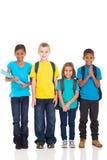 Écoliers sur le blanc Photos stock