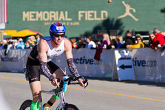 Colin Gundling in the Coeur d' Alene Ironman cycling event. COEUR D ALENE, ID -  JUNE 23: Colin Gundling, Triathlete on the bike part of the ironman triathlon Royalty Free Stock Images