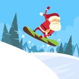 Colina de Santa Clause Snowboarder Sliding Down Imagenes de archivo
