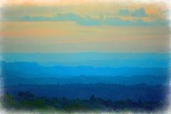 Colinas en un campo con colores hermosos de la noche inminente en la 'hora azul ' Imagen intencionalmente borrosa - efecto del wa fotografía de archivo libre de regalías
