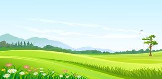 Colinas verdes, cielo azul y camino solo Fotos de archivo libres de regalías