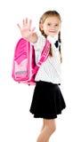 Écolière de sourire avec le sac à dos disant au revoir Image stock