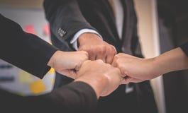 Colisão de quatro punhos na reunião para o conceito da equipe fotos de stock royalty free
