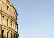 The coliseum. A detail of the coliseum in Rome, Italy, on a clean blue sky background Stock Photo