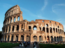 Coliseum. Tourists stroll and take pictures near the Coliseum in Rome, Italy Stock Images