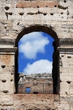 Coliseum arch detail in Rome. Coliseum ancient arch with blue sky and clouds Stock Photo