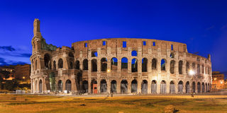 Coliseum Back Pan Rise. Italy rome coliseum back panoramic view at sunrise blue sky illuminated archs and levels of this ancient roman emperor building national Stock Images