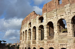 Coliseum with clouds. Southern facade arches of Coliseum with cloudy sky Royalty Free Stock Image
