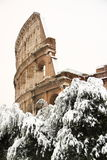 The Coliseum covered by snow. A really rare event in Rome stock photos