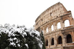 The Coliseum covered by snow. A really rare event in Rome stock photo