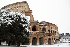 The Coliseum covered by snow. A really rare event in Rome Royalty Free Stock Image