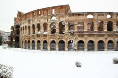 The Coliseum covered by snow. A really rare event in Rome stock photography