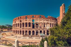 Coliseum at daytime over blue sky Stock Photo