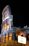 Coliseum by night. Rome - Colosseo at night, side view, with VIA SACRA (holy street) sign Royalty Free Stock Photography