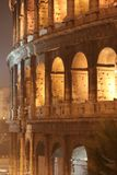 Coliseum Night (Colosseo - Rome - Italy). Details of the Coliseum - Night (Colosseo - Rome - Italy) - Lights shadows on the ancient monument of the Roman Empire stock photo