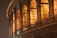 Coliseum Night (Colosseo - Rome - Italy). Details of the Coliseum - Night (Colosseo - Rome - Italy) - Lights shadows on the ancient monument of the Roman Empire royalty free stock photo