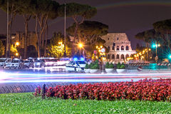 Coliseum in the night with police car Royalty Free Stock Photos