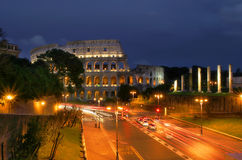 Coliseum at night in Rome, Italy. Famous roman Coliseum and illuminated streets of Rome at night Royalty Free Stock Photos