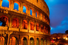 Coliseum by night with traffic, Rome Italy Royalty Free Stock Image