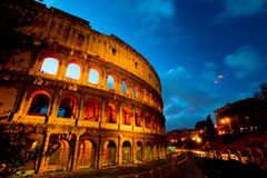 Coliseum by night with traffic, Rome Italy Stock Photos