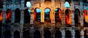 Coliseum by night with traffic, Rome Italy Royalty Free Stock Photo