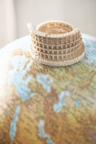 Coliseum of Rome on globe Royalty Free Stock Images