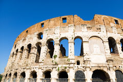 Coliseum in Rome Italy. On blue sky background Stock Photos