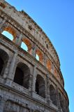 Coliseum in Rome. Italy, the blue sky on background Stock Image