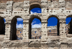 Coliseum in Rome. Coliseum monumental arcades with blue sky in Rome Stock Photo