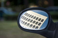 Coliseum square reflection. Picture of the Coliseum Square reflection in the rearview mirror. The Palazzo della Civiltà Italiana is found in Rome, is known as royalty free stock photography