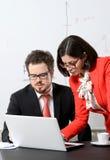 Collègues d'affaires travaillant ensemble Photos stock