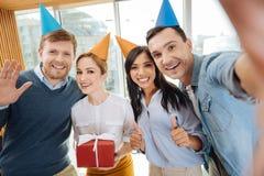 Collègues heureux ayant la grande partie Images libres de droits