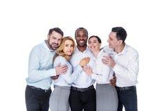 Collègues heureux se tenant ensemble et étreignant Photos stock
