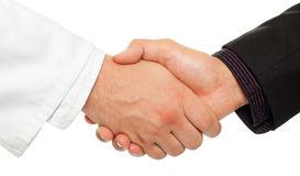 Collaboration. Handshake between a businessman and a doctor, isolated on white Stock Photo