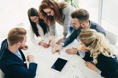 Collaboration and analysis by business people working in office. Collaboration and analysis by business people working in business office Royalty Free Stock Photos
