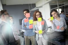 Collaboration and analysis by business people working in office. Collaboration and analysis by business people working in business office royalty free stock image
