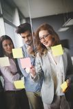 Collaboration and analysis by business people working in office Royalty Free Stock Photo