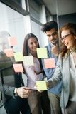 Collaboration and analysis by business people working in office Stock Images