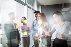 Collaboration and analysis by business people working in office Royalty Free Stock Images