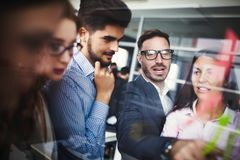 Collaboration and analysis by business people working in office Royalty Free Stock Image