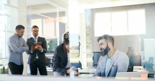 Collaboration and analysis by business people working in office Stock Photography