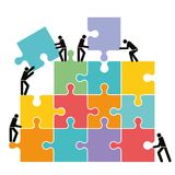 Collaboration and connection. A concept illustration of people collaborating building a jigsaw puzzle Stock Photography