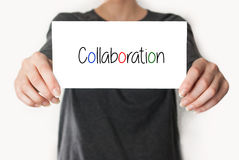 Collaboration. female showing card Stock Image