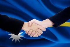 Collaboration handshake with flag of Nauru Stock Images