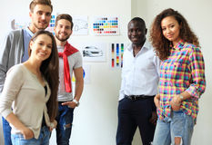 Collaboration is a key to best results. Group of young modern people in smart casual wear planning business strategy stock photo