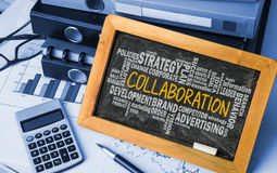 Collaboration with related word cloud Royalty Free Stock Photography