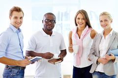 Collaborative team. Multi-racial team of four being ready to collaborate royalty free stock photo
